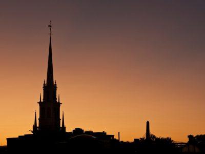 Boston's historic skyline basked in the light of the setting sun