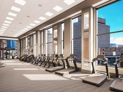Fitness center at Sudbury luxury condos. Treadmills by windows with view of Boston, 2 blue exercise balls