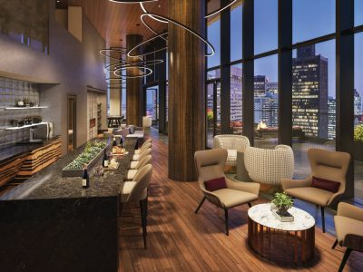 Two story sky lounge with granite topped bar, big TV, comfy chairs, amazing deck with views